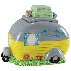 This cookie jar's playful design conceals your fresh-baked goods with a graceful ceramic structure and spacious interior. Full graphic text: Happy campers eat W x H x DCeramicHand washImported Retro Campers, Happy Campers, Vintage Campers, Vintage Rv, Vintage Motorhome, Camper Trailers, Ceramic Cookie Jar, Cookie Jars, Cookie Containers