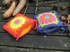 """no pattern here; just a pic--but totally hackable.  crochet two granny squares, stitch together on three sides, line with a fat quarter, sew in a short zipper along the top.  Cute quick gift for office mates, stocking stuffer, or a great handmade """"package"""" for a small gift!"""