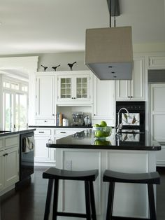 White and black. Like the minimalist birds above the cabinet decor