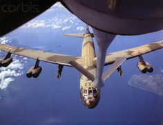 U.S. Air Force bomber approaches a KC-135 aerial tanker for refueling prior to a strike in Vietnam. Air Force B-52 Stratofortress bombers are being used to support American ground forces.