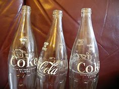 VINTAGE COCA COLA GLASS BOTTLES