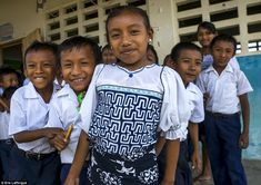 Pictured are Kuna children outside their school. Even school uniforms on the islands are influenced by mola art
