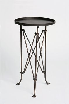 Urban Outfitter's Metal Accordion Side Table- would make a great drinks table, especially with some antiqued mirrored glass cut to fit the top $64.00