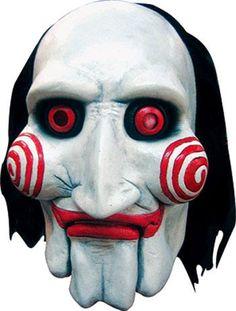 Jigsaw Maske aus dem Film Saw. Die fiese Bauchredner Puppe Billy überbringt meist keine guten Nachricht und bedeutet somit den Tod. Super Halloween Maske und Merchandise für Saw Fans
