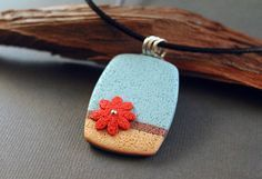 Polymer clay pendant by EarthExpressions at Etsy.