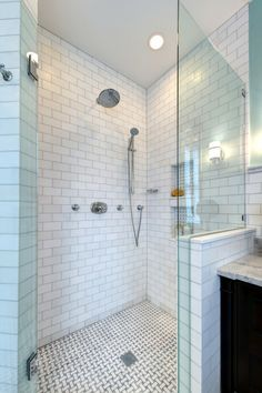 One fine stay bathrooms white subway tile subway tile for Small art deco bathroom ideas