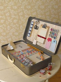 Vintage suitcase used for craft supply storage