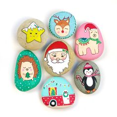 Learn how to make these cute painted christmas rocks and the best rock paintinh supplies to use.