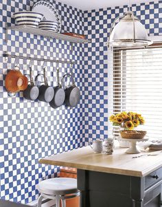 It looks like tile, but it's wallpaper! $25.99/roll  Read more: Creating a Colorful & Inviting Home on a Budget - Country Living Follow us: @Elizabeth Cassinos Living Magazine on Twitter | CountryLiving on Facebook Visit us at CountryLiving.com