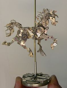 Work of Sculptor, Sue Beatrice.  She uses all vintage clock parts. Clockwork Carousel Horse