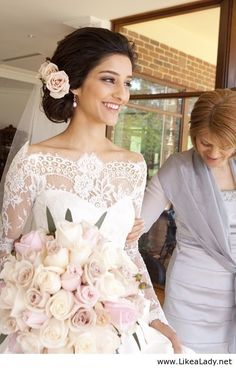 Beautiful lace detailing around the collar and pale blush rose