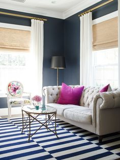 Lovely Layers Navy Walls Drapery With Grass Cloth Shades Graphic Pattern On Rug Softness Of Sofa Curved Lines