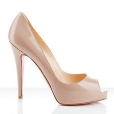Nude pumps by Christian Louboutin.