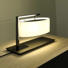 the couturier of contemporary lighting. This Contardi Kira Table Lamp features an elegantly patterned bronze base, sleek suspension arm and touch sensitive switch, a truly representative piece in the modernest form. Nightstand Lamp, Bedside Table Lamps, Bedroom Lamps, Desk Lamp, Diy Lamps, Bedroom Stuff, Lamp Table, Master Bedroom, Night Table Lamps