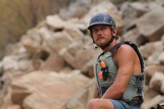 (Francisco Kjolseth  |  The Salt Lake Tribune)  They call him El Bigote as river guide Alex Jahp takes up a safety position on a rapid along Cataract Canyon after finding a kayaking helmet among the rocks.