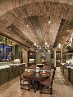 Tuscan kitchen with a brick barrel ceiling and distressed, green painted cupboards (via Thom Oppelt : Designers' Portfolio 4287&#...
