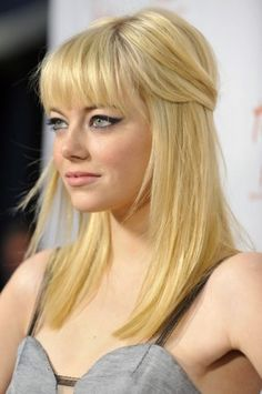 Emma Stone with blond hair...she can pull it off I must say...love the bangs and color i'm trying to get my hair this color.