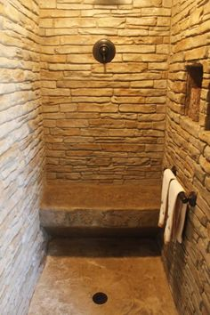 Stamped concrete shower.... You could add a stuck on mould to icf quad lock so when the concrete is poured it comes out like real stone... Take this idea to quad lock themselves and they could injection mould the polystyrene themselves! :)