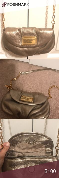 🎉Host Pick🎉MARC by Marc Jacobs cross body bag Gorgeous gold cross body bag by MARC by Marc Jacobs bag. Brushes gold hardware, magnetic clasp to close. Interior in excellent condition with two compartments and card holders. This bag is in excellent condition and only used a few times. Perfect for the holidays Marc By Marc Jacobs Bags Crossbody Bags