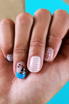Shark Week Nails? Happy Summer To Us #refinery29  http://www.refinery29.com/2014/05/68173/scratch-summer-nail-wraps#slide2  Anchors, boats, and stripes, oh my!