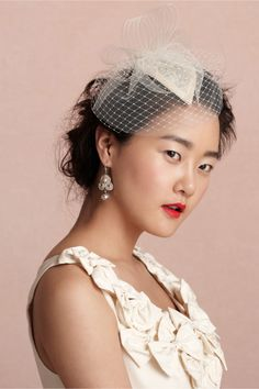 Cloud Mist Bibi from BHLDN- I think this would be perfect- and no feathers! :)