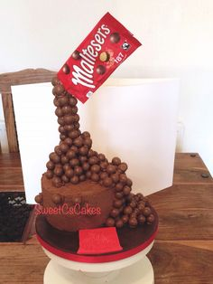 Tower of malteasers cake.