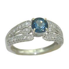 Blue Topaz Ring with 0.60 Cttw. https://www.goldinart.com/shop/rings/colored-gemstone-rings/blue-topaz-ring-0-60-cttw #14KaratWhiteGold, #BlueTopaz