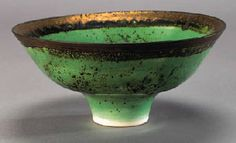 Footed bowl, Porcelain covered in an apple-green glaze with dark brown flecks and lustrous bronze run rim, c.1980