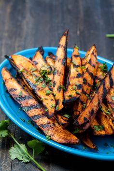 These Smokey Grilled Sweet Potato Wedges are full of flavor. They're super simple to whip up and contain only 4 ingredients – Southwestern Pork Rub, Sweet Potatoes, Oil, and Cilantro for Garnish. @goodlifeeats www.goodlifeeats.com