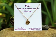 "In honor of Mother's Day, gift her this beautiful necklace with a meaningful message that reads, "" Mom. You Mean the World to Me. I Love You."" 14k Gold Filled Chain or Sterling Silver Chain with Earth pendant."