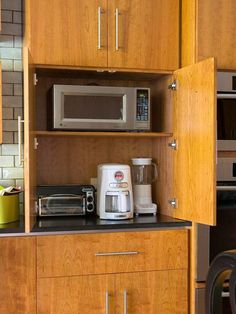 Clear the Countertops: Your kitchen countertops should hold only things you use daily. Create a permanent spot for everything else, including small appliances. Store things close to where you use them.  I would make this door be able to retract into the cupboard.