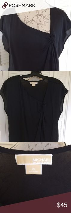 "MICHAEL KORS silk top, NWOT Michael Kors short sleeved, black, silk blouse. NWOT, in pristine conditions. Asymmetrical neckline ends with a beautiful ruched knot which gives more volume to the front and forms an A line. Size is 1X but fits XL fine too. Pit to pit bust width is 23.5"", shoulder to hem length 28"". Michael Kors Tops Blouses"