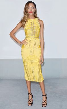 Jourdan Dunn wearing a yellow Balmain dress and black heels