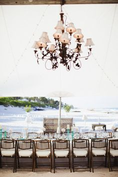 Talk about bringing the outdoors in.   LOCATION: Pink Sands Beach I ISLAND: Harbour Island, Eleuthera, Bahamas I Event + Floral Design: littleislanddesign.com I PHOTOGRAPHY: Saraandrocky.com