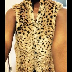 ANIMAL PRINT VEST WITH POCKETS! Perfect for fall! TRENDY FAUX FUR ANIMAL PRINT VEST with pockets and clasp closures. Size Medium . Very Warm . Worn once!  Swool Jackets & Coats Vests