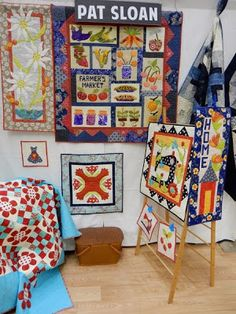 A Quilting Life - a quilt blog: Quilt Market Minneapolis Part 2: Moda-Love the little sewing machine wallhanging.