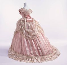 Evening dress 1866 France - The Kyoto Costume Institute - Bodice of sheer ivory stripped silk with pink silk taffeta ; tripple-layered skirt (sheer ivory stripped silk skirt and over skirt, and pink silk taffeta underskirt) ; worn over large crinoline. 1800s Fashion, 19th Century Fashion, Victorian Fashion, Vintage Fashion, Vintage Outfits, Vintage Gowns, Historical Costume, Historical Clothing, Historical Dress