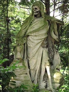 Death/Reaper at a graveside, complete with hourglass representing the passing of time. Melaten-Friedhof cemetery.