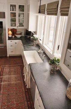 I get a lot of questions asking about my experience with the soapstone countertops in the kitchen.  The...