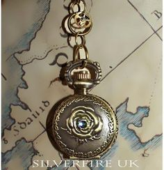 vintage_rose_pocket_watch_large.jpg (463×480)