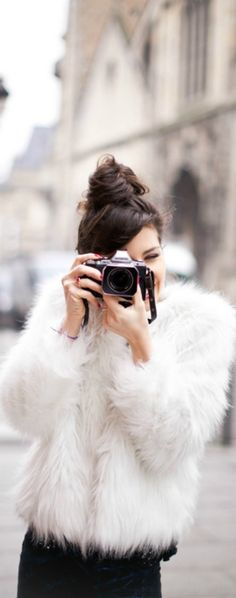Say cheese! A faux fur jacket will make you stand out in any photo this season.