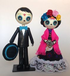 Super cute niño y niña Catrina completely handmade using recycled materials, the head is made out of clay and the body was made of recycled carboard and paper mache. They measures 15.5 cms. tall. It is a delicated piece, not a toy. *** READY TO SHIP***