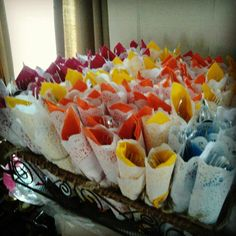 Wrap silverware in colored napkins, a doily, and tie with twine. Adorable shower or graduation party idea :)