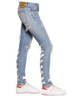 https://cdnd.lystit.com/photos/b647-2015/12/24/off-white-blue-spray-paint-cotton-denim-jeans-product-3-329497801-normal.jpeg