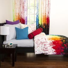 Siscovers   Crayola Cosmic Burst   Bursting color contrasted between black and white. This vivid Crayola collection will energize any room. People of all ages will love this colorful comforter set shown with a sheet set, euro pillow, toss pillows, bolster pillow and drapery. #HPmkt