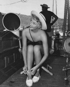 Rita Hayworth. Tying laces.