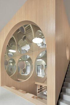 """Our love for arches as a structural element, but also as a welcoming gesture and symbol of entrance manifested itself in this project. With the reflective walls, the arches transform from a physical to a intangible element and connect with each other to one endless swing. A space that connects reality and imagination.'"