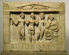 "Marble plaque depicting the Graces in front of a matrona; originally funerary, it seems to have been later reused, as a shop sign (inscription: AD SORORES IIII ""At the Four Sisters"") for a lupanare. Roman, 70-100 CE. Pergamon Museum."