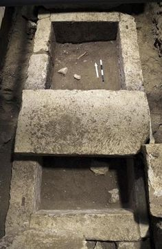 Ancient coins found in mystery tomb