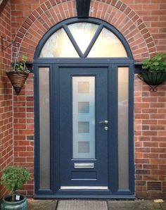 A stunning Bespoke Vogue Ultimate Rockdoor in Anthracite Grey with side windows fitted and Cube Glass Design. #homeimprovement